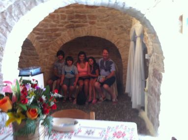The locals told us to sit on their marital bed for a photo shot.